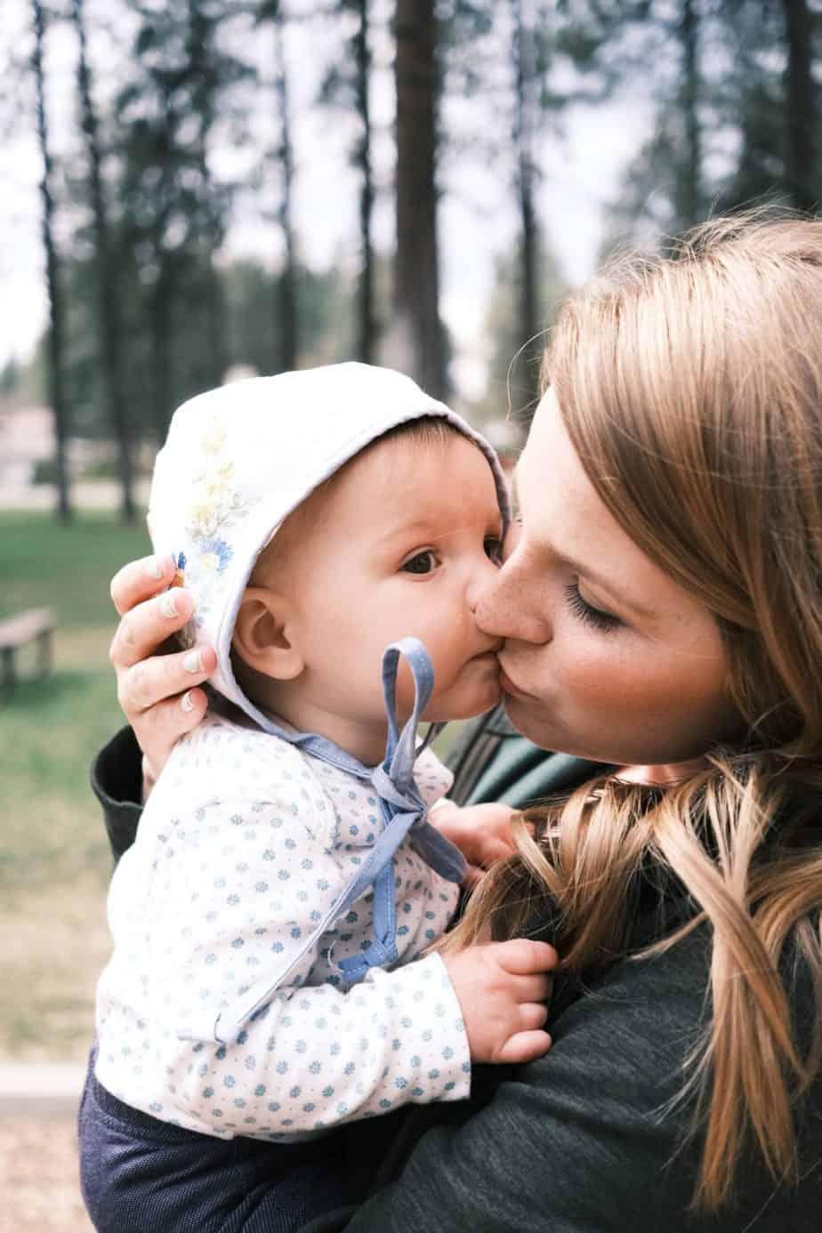 baby kissing mom